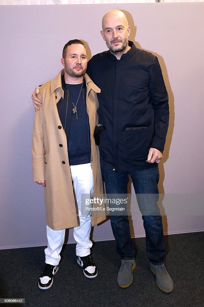 Stylist Kim Jones and Actor Jake Chapman pose Backstage after the Louis Vuitton Menswear Fall/Winter 2016-2017 Fashion Show as part of Paris Fashion Week. Held at 'Parc Andre Citroen' on January 21, 2016 in Paris, France.