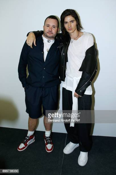Stylist Kim Jones and actor Will Peltz pose after the Louis Vuitton Menswear Spring/Summer 2018 show as part of Paris Fashion Week on June 22 2017 in...