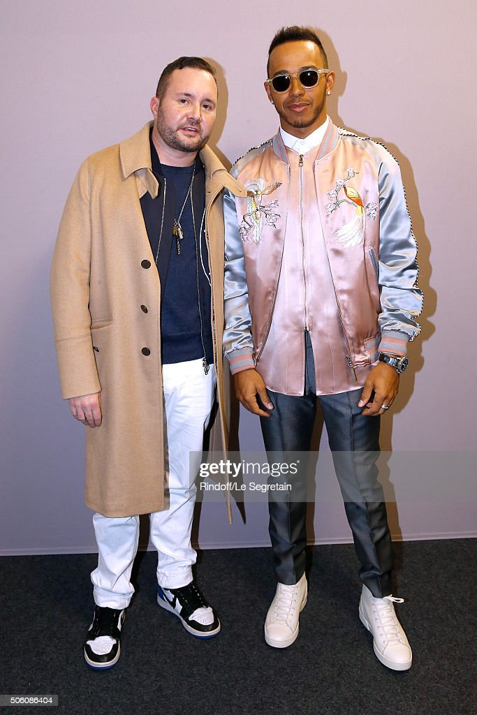 Stylist Kim Jones and Champion of the World, Driver Lewis Hamilton pose Backstage after the Louis Vuitton Menswear Fall/Winter 2016-2017 Fashion Show as part of Paris Fashion Week. Held at 'Parc Andre Citroen' on January 21, 2016 in Paris, France.