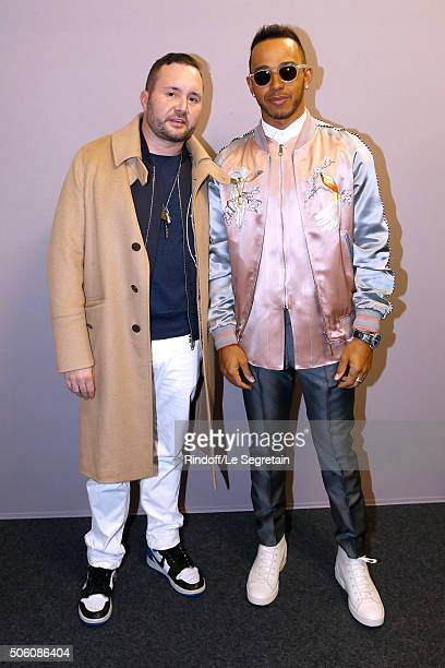 Stylist Kim Jones and Champion of the World Driver Lewis Hamilton pose Backstage after the Louis Vuitton Menswear Fall/Winter 20162017 Fashion Show...