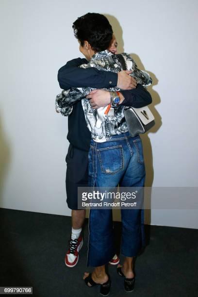 Stylist Kim Jones and Farida Khelfa Seydoux pose after the Louis Vuitton Menswear Spring/Summer 2018 show as part of Paris Fashion Week on June 22...