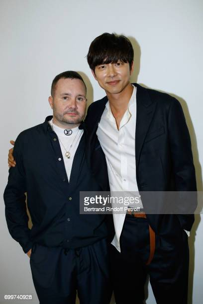 Stylist Kim Jones and Gong Yoo pose after the Louis Vuitton Menswear Spring/Summer 2018 show as part of Paris Fashion Week on June 22 2017 in Paris...