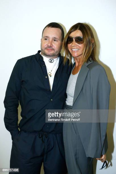 Stylist Kim Jones and journalist Carine Roitfeld pose after the Louis Vuitton Menswear Spring/Summer 2018 show as part of Paris Fashion Week on June...