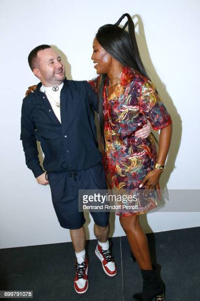 Stylist Kim Jones and model Naomi Campbell pose after the Louis Vuitton Menswear Spring/Summer 2018 show as part of Paris Fashion Week on June 22...