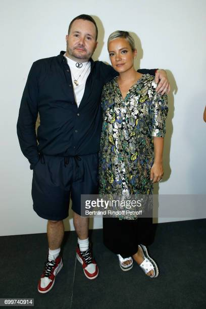 Stylist Kim Jones and singer Lily Allen pose after the Louis Vuitton Menswear Spring/Summer 2018 show as part of Paris Fashion Week on June 22 2017...