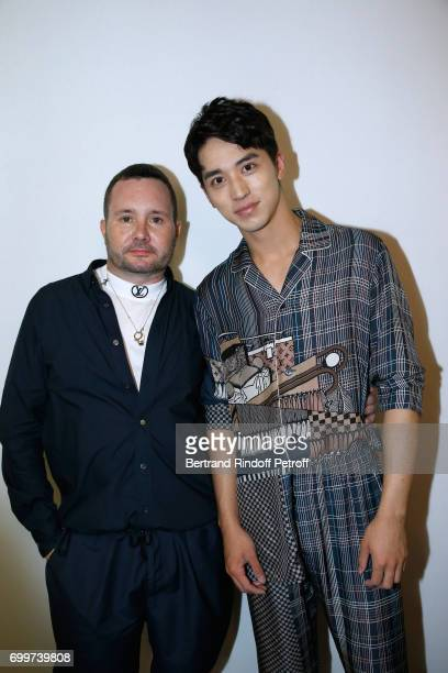 Stylist Kim Jones and Xu Weizhou pose after the Louis Vuitton Menswear Spring/Summer 2018 show as part of Paris Fashion Week on June 22 2017 in Paris...