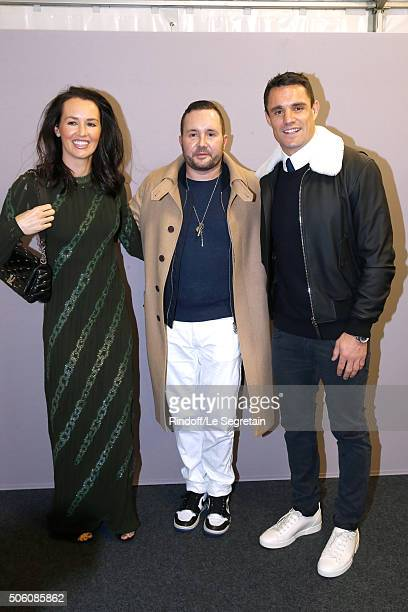 Stylist Kim Jones pose Backstage between New Zealand Rugby Player and Champion of the World with 'All Blacks' Dan Carter and his wife Honor Carter...