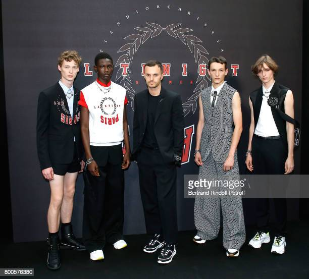 Stylist Kris Van Assche and his Models pose Backstage after the Dior Homme Menswear Spring/Summer 2018 show as part of Paris Fashion Week on June 24...