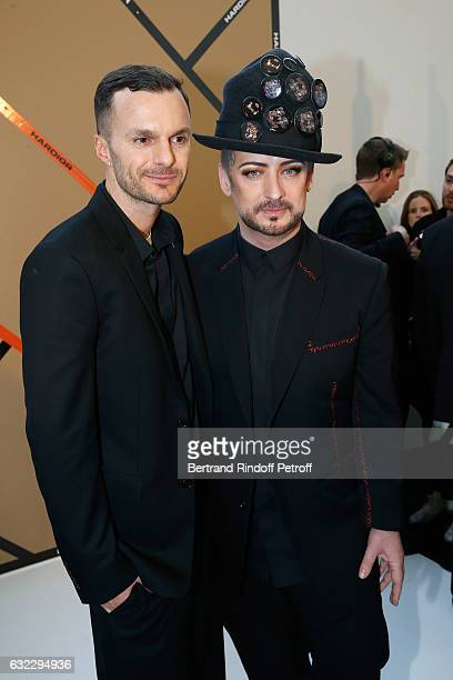 Stylist Kris Van Assche and singer Boy George pose backstage after the Dior Homme Menswear Fall/Winter 20172018 show as part of Paris Fashion Week on...