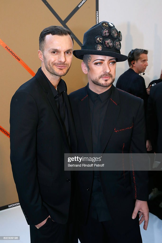 Stylist Kris Van Assche and singer Boy George pose backstage after the Dior Homme Menswear Fall/Winter 2017-2018 show as part of Paris Fashion Week on January 21, 2017 in Paris, France.