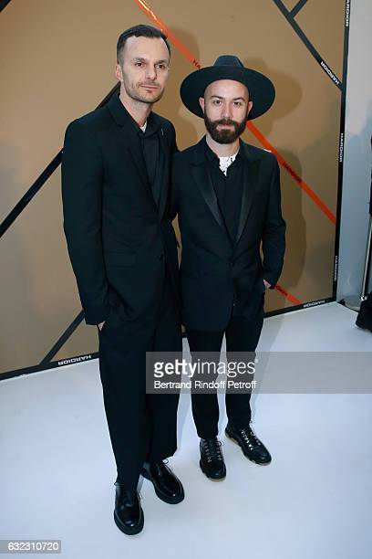 Stylist Kris Van Assche and Woodkid pose backstage after the Dior Homme Menswear Fall/Winter 20172018 show as part of Paris Fashion Week on January...