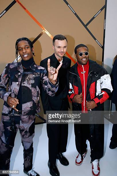 Stylist Kris Van Assche standing between Rappers ASAP Ferg ASAP Rocky pose backstage after the Dior Homme Menswear Fall/Winter 20172018 show as part...