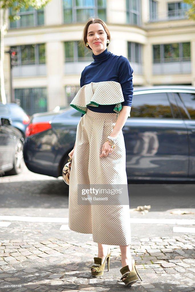 Stylist Lauren Kennedy Malpas poses wearing an Anna October dress before the Miu Miu show at the Palais de Iena during Paris Fashion Week SS16 on...