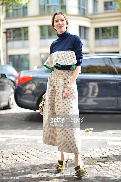 Stylist Lauren Kennedy Malpas poses wearing an Anna October dress before the Miu Miu show at the Palais de Iena during Paris Fashion Week SS16 on...