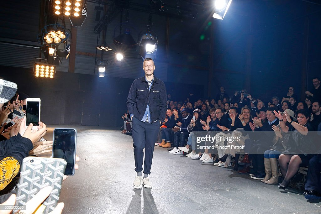 Stylist Lucas Ossendrijver acknowledges the applause of the audience at the end of the Lanvin Menswear Fall/Winter 2016-2017 show as part of Paris Fashion Week on January 24, 2016 in Paris, France.