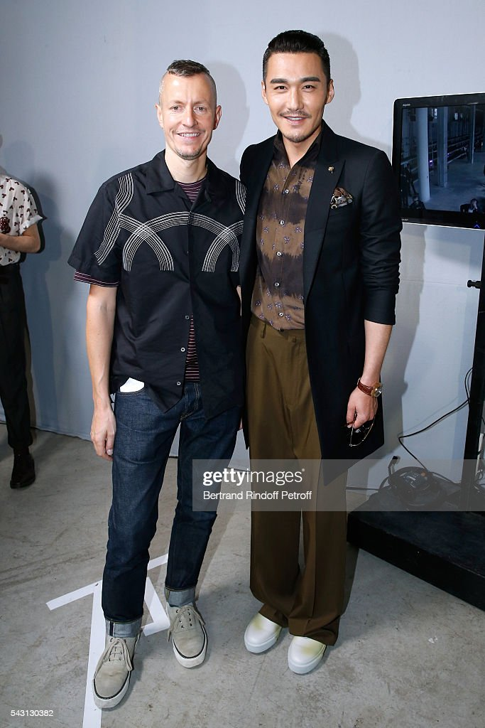 Stylist <a gi-track='captionPersonalityLinkClicked' href=/galleries/search?phrase=Lucas+Ossendrijver&family=editorial&specificpeople=5531949 ng-click='$event.stopPropagation()'>Lucas Ossendrijver</a> and actor Bing Hu attends the Lanvin Menswear Spring/Summer 2017 show as part of Paris Fashion Week on June 26, 2016 in Paris, France.