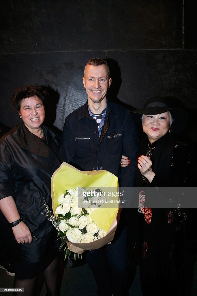 Stylist Lucas Ossendrijver standing between General Director of Lanvin Michele Huiban (L) and Owner of Lanvin Shaw Lan Wang (R) attend the Lanvin Menswear Fall/Winter 2016-2017 show as part of Paris Fashion Week on January 24, 2016 in Paris, France.