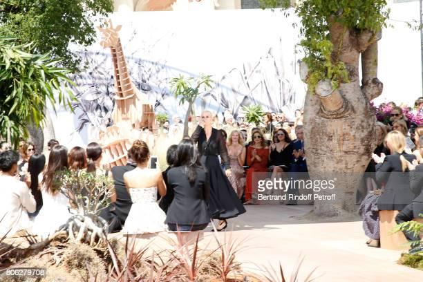 Stylist Maria Grazia Chiuri acknowledges the applause of Sandrine Kiberlain Marisa Berenson Natalie Portman Owner of LVMH Luxury Group Bernard...