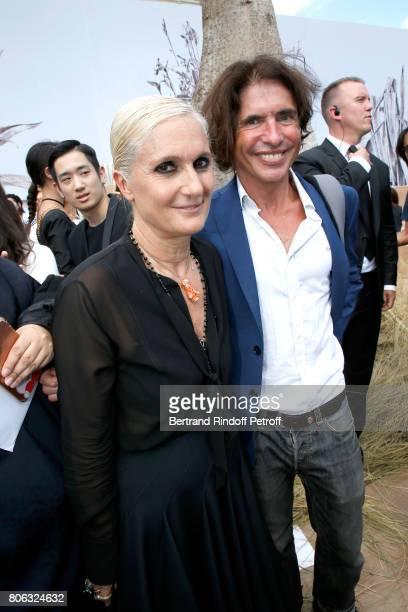 Stylist Maria Grazia Chiuri and Arno Klarsfeld pose backstage after the Christian Dior Haute Couture Fall/Winter 20172018 show as part of Haute...