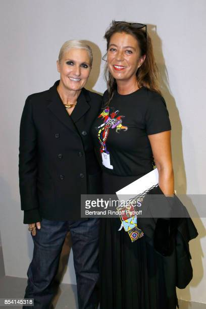 Stylist Maria Grazia Chiuri and GrandDaughter of Niki de Saint Phalle Bloum Cardenas pose backstage after the Christian Dior show as part of the...