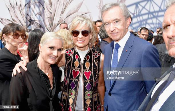 Stylist Maria Grazia Chiuri Owner of LVMH Luxury Group Bernard Arnault and his wife Helene Arnault pose backstage at the Christian Dior Haute Couture...