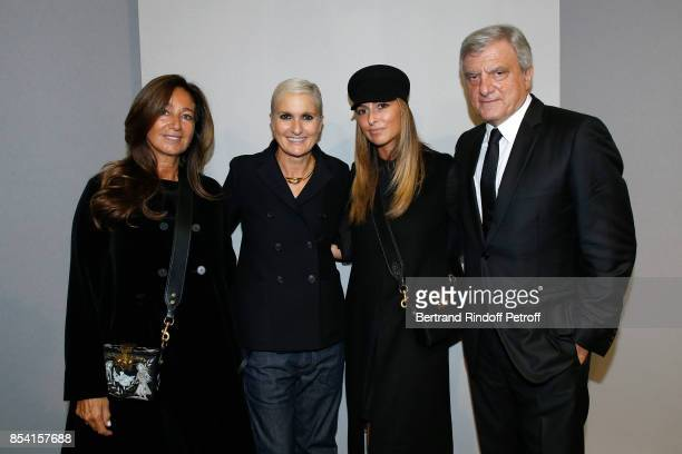 Stylist Maria Grazia Chiuri standing between CEO Dior Sidney Toledano his wife Katia Toledano and their Daughter Julia pose backstage after the...