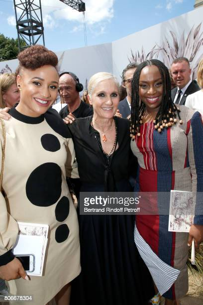 Stylist Maria Grazia Chiuri standing between guests pose backstage after the Christian Dior Haute Couture Fall/Winter 20172018 show as part of Haute...