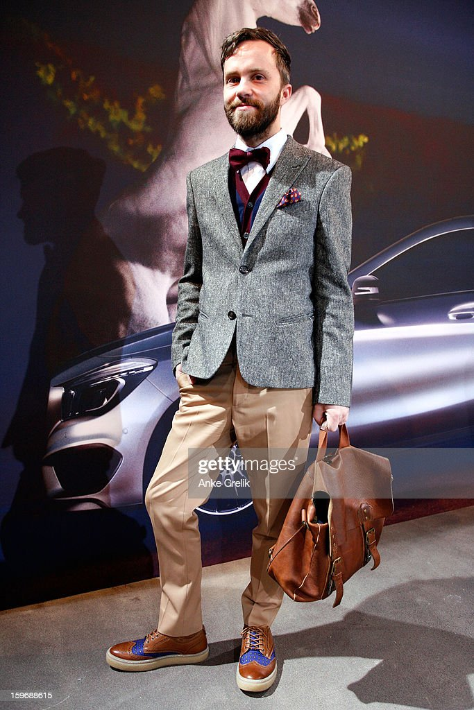 Stylist Matthias Huber wearing Maison Martin Margiela trouser, Paul Smith shirt, Paul Werth vest, Fred Perry shoes attends Mercedes-Benz Fashion Week Autumn/Winter 2013/14 at the Brandenburg Gate on January 18, 2013 in Berlin, Germany.