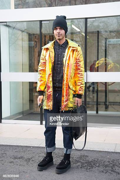 Stylist Nicholas Collins wears a Wanda Nylon coat shoes by Tuk DSquared Jeans and shirt and Givenchy bag day 3 of Paris Haute Couture Fashion Week...