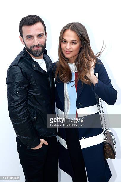 Stylist Nicolas Ghesquiere and Alicia Vikander pose backstage after the Louis Vuitton show as part of the Paris Fashion Week Womenswear Fall/Winter...
