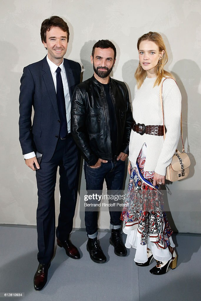 Stylist Nicolas Ghesquiere standing between General manager of Berluti Antoine Arnault and Natalia Vodianova pose after the Louis Vuitton show as part of the Paris Fashion Week Womenswear Spring/Summer 2017 on October 5, 2016 in Paris, France.