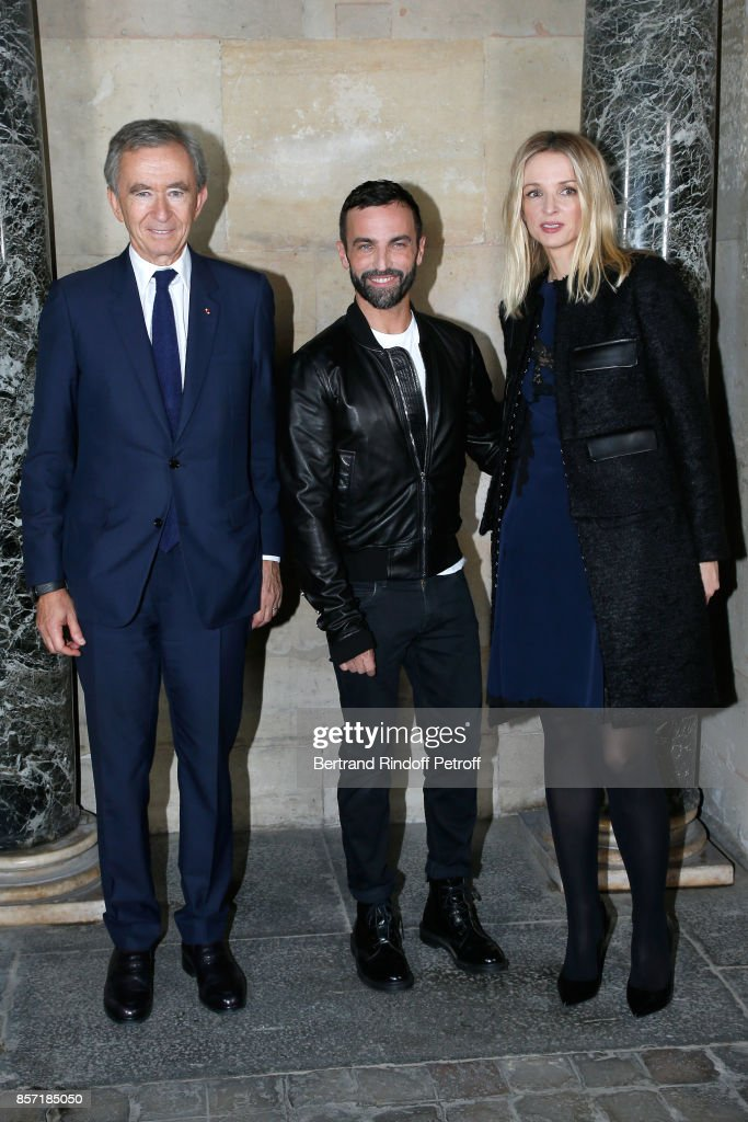 stylist-nicolas-ghesquiere-standing-between-owner-of-lvmh-luxury-picture-id857185050
