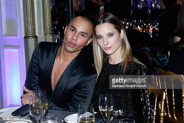 Stylist of Balmain Olivier Rousteing and Ilona Smet attend the Annual Charity Dinner hosted by the AEM Association Children of the World for Rwanda...