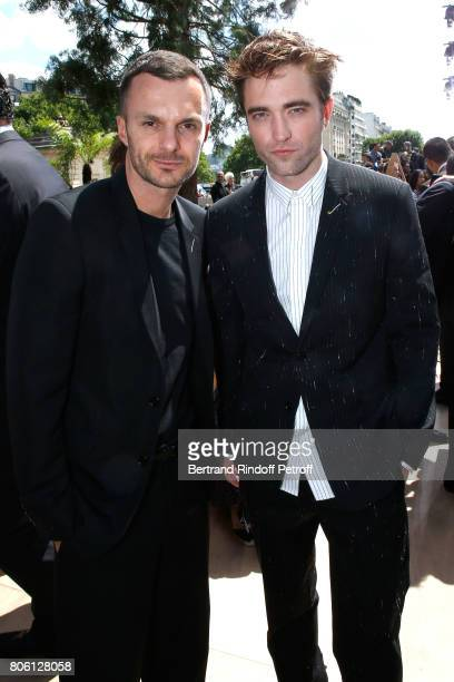 Stylist of Dior men Kris Van Assche and actor Robert Pattinson attend the Christian Dior Haute Couture Fall/Winter 20172018 show as part of Haute...
