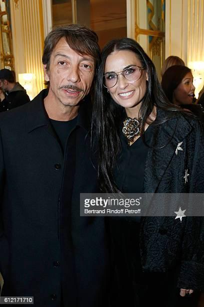 Stylist of Valentino Pierpaolo Piccioli and actress Demi Moore attend Alber Elbaz receives the Insigna of 'Officier de la Legion d'Honneur' at...