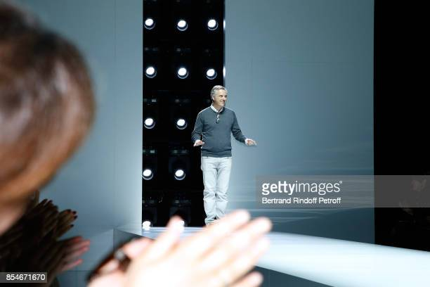 Stylist Olivier Lapidus acknowledges the applause of the audience at the end of the Lanvin show as part of the Paris Fashion Week Womenswear...