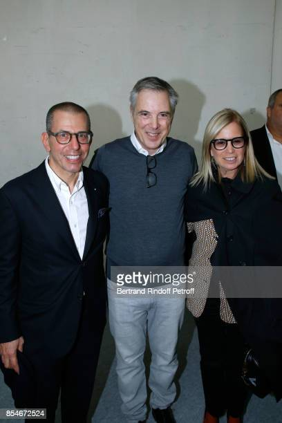 Stylist Olivier Lapidus standing between Jonathan Newhouse and his wife Ronnie Cook Newhouse pose Backstage after the Lanvin show as part of the...
