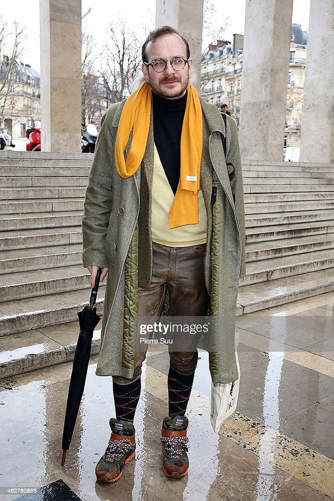 Stylist Olivier wears a Christophe Lemaire coat,Marks & Spencer Jacket,Vivienne Westwood Jumper,Bernhard Willhelm shoes,Burlington Socks,vintage Leather Pants on January 15, 2014 in Paris, France.