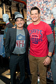 Stylist Phillip Bloch and New York Giants punter Steve Weatherford attend Junk Food Clothing's 2014 NFL Playoff Tailgate Party at Bloomingdale's on...