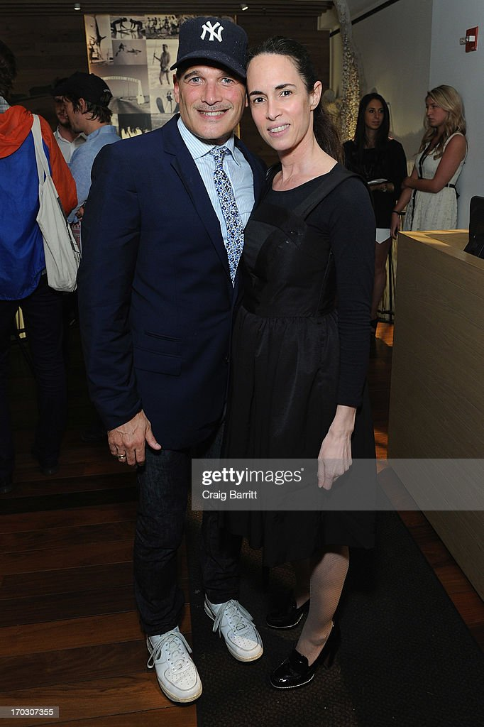 Stylist Phillip Bloch poses with guest at DuJour Magazine Summer Issue celebrating the Julianne Moore cover on June 10, 2013 at The Marlin Bar at Tommy Bahama in New York City.