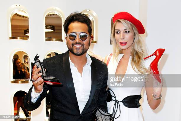Stylist Samuel Sohebi and model Annika Gassner during the Christian Louboutin Store Opening on June 23 2017 in Munich Germany