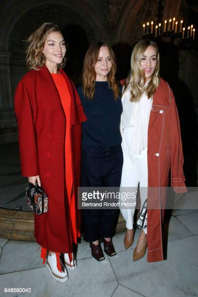 Stylist Stella McCartney standing between Formula One Driver Carmen Jorda and Arizona Muse pose after the Stella McCartney show as part of the Paris...