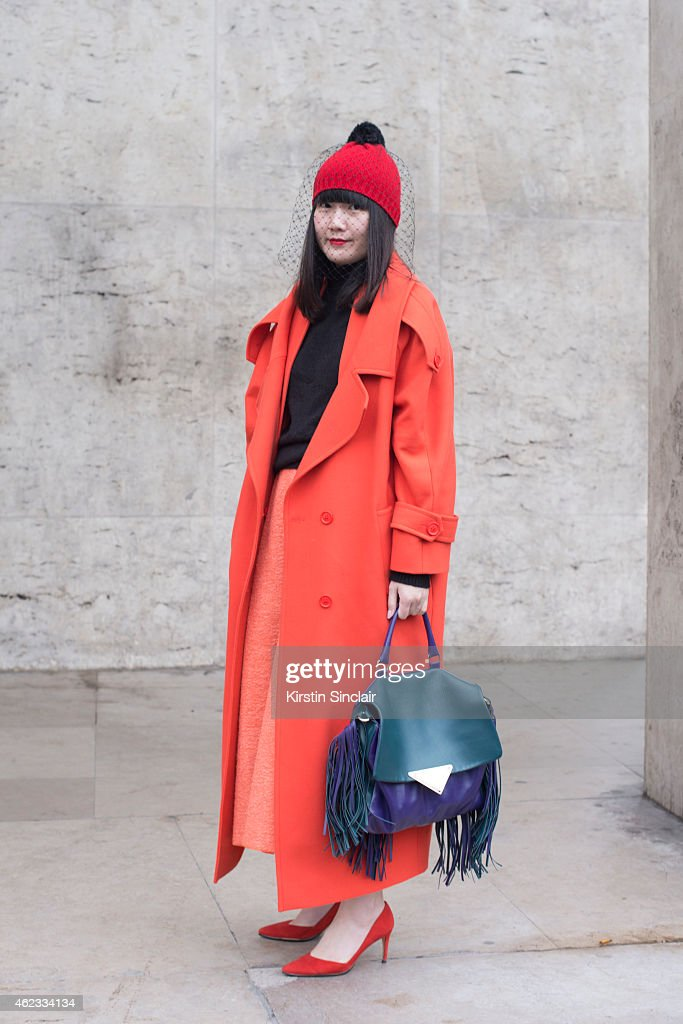 Stylist Stila Chen wears a coat by Preen bag by Sara Battaglia beanie by Bernstock Speirs and Roksanda Illienchic skirt on day 2 of Paris Haute...