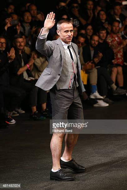 Stylist Thom Browne acknowledges the applause of the audience after the Thom Browne show as part of the Paris Fashion Week Menswear Spring/Summer...