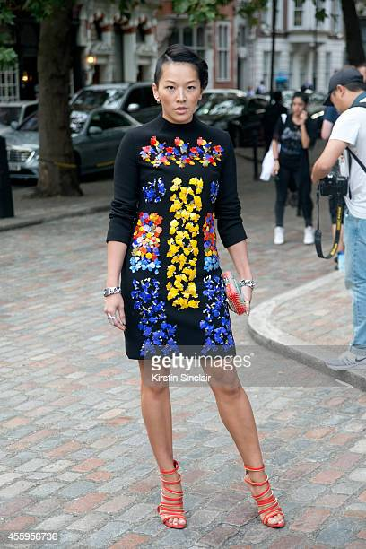 Stylist Tina Leung is wearing a Peter Pilotto dress on day 4 of London Collections Women on September 15 2014 in London England