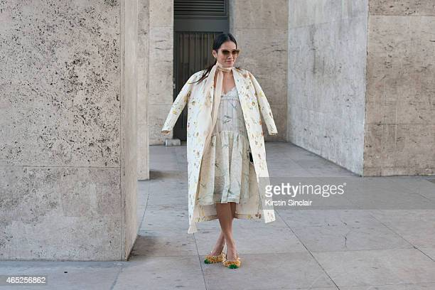 Stylist Tina Leung wears Rochas coat dress and shoes and Dita sunglasses on day 2 of Paris Collections Women on March 04 2015 in Paris France