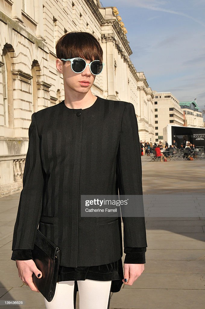 Stylist Tomas Toth wears Dior black 1960s vintage jacket, H & M black and white two tone leggins, CIAK vintage bag, vintage sunglasses and ring from Top Shop during London Fashion Week Autumn/Winter 2012 on February 21, 2012 in London, England.
