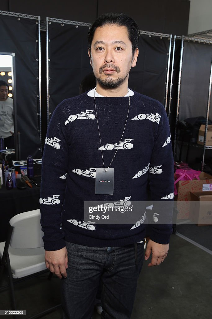 Stylist, Tomo Jidai, prepares backstage at the LIE SANGBONG Fall-Winter 2016 Collection Show at Pier 59 on February 13, 2016 in New York, New York.