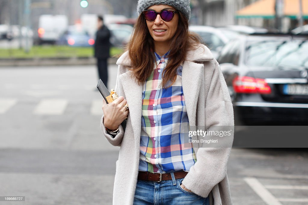 Stylist Viviana Volpicella is seen durimg the Milan Fashion Week on January 15, 2013. She's wearing a Marella coat, Current Elliott jeans.