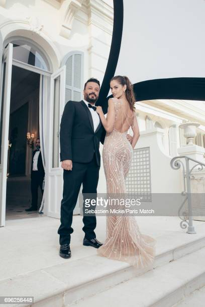 Stylist Zuhair Murad and fashion model Izabel Goulart are photographed for Paris Match whilst attending the Amfar Gala at the Eden Roc Hotel on May...
